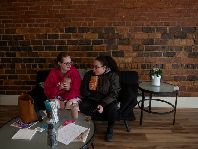 Nicole Lyke, of Streetsboro, and Stephanie Bruckner, of Ravenna, have drinks together at Ravenna Nutrition. Nicole samples a frozen hot chocolate flavored meal replacement smoothie and Stephanie tries an orange mega tea on Jan. 5.