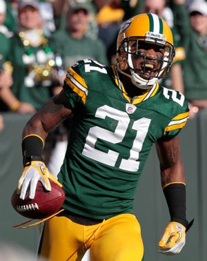 Green Bay Packers cornerback Charles Woodson (21) reacts after running back an interception for a touchdown during the first half against the Denver Broncos, in Green Bay, Wis., Oct. 2, 2011. (AP Photo/Mike Roemer, File)