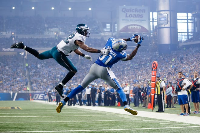 Lions wide receiver Calvin Johnson, defended by Eagles cornerback Eric Rowe (32) , catches a pass for a touchdown during the second half in Detroit, Nov. 26, 2015. The 30-year-old receiver, known as Megatron, announced his decision Tuesday, March 8, 2016, to retire from the NFL after nine mostly spectacular seasons with the Detroit Lions. (AP Photo/Rick Osentoski, File)