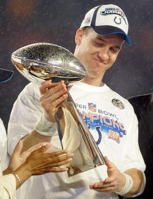 Indianapolis Colts QB Peyton Manning holds the Vince Lombardi Trophy after the Colts' 29-17 win over the Chicago Bears in the Super Bowl XLI at Dolphin Stadium in Miami, Feb. 4, 2007. After selecting him with the top overall pick in 1998, the franchise made a dramatic turnaround. Manning led the Colts to their most successful decade since the 1960s and their first Super Bowl title since 1971. (AP Photo/Amy Sancetta, File)