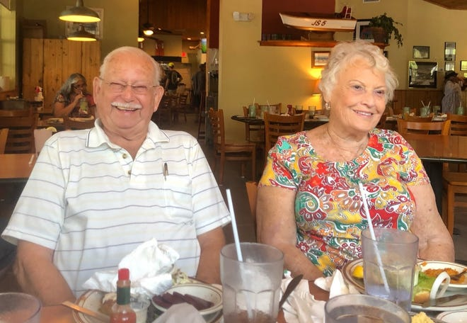 Roger and Betty Colee, of St. Johns County, smile for a photo in 2018 at Aunt Kate's restaurant. The Colees, both 83, died five days apart from each other after being hospitalized with COVID-19.