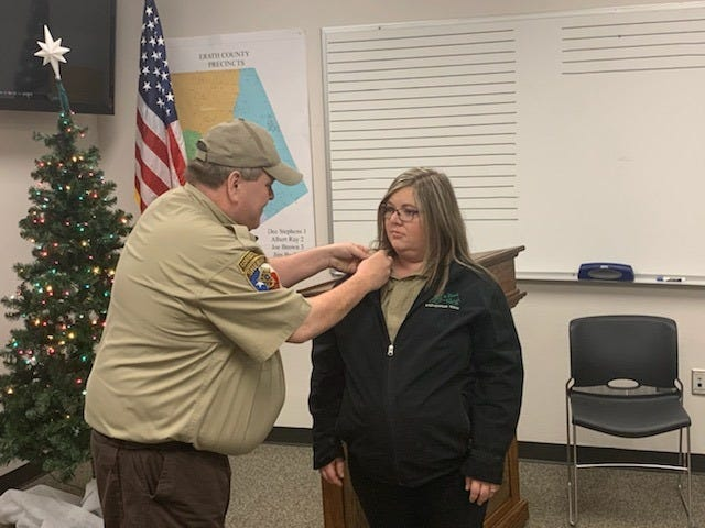 The Erath County Sheriff's Office recently promoted two individuals in the jail division. Capt. Danny Clayton is pictured promoting Sarah Logan to the rank of lieutenant. Logan will help supervise the daily operations of the jail.
