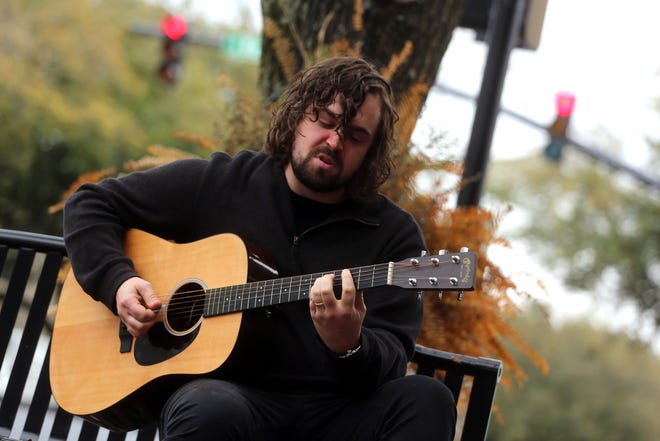 Pistol Hill performs music in uptown Shelby on Tuesday.