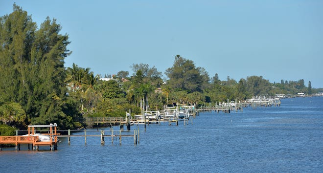 Docks of homes along the private and gated N. Manasota Key Rd.  Manasota Key is a barrier island between Venice and Englewood. It is divided by Charlotte County to the south and Sarasota County to the north.