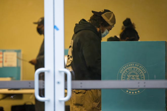 Voters cast their ballots in the runoff election Tuesday morning at Coastal Cathedral Church.