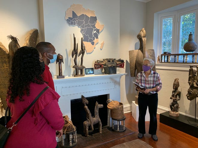 A volunteer docent at the Savannah African Art Museum explains the background of what they are seeing at the museum on East. 37th Street on Dec. 23. Docents learn about the many types of African art, the many cultures and then share that information with guests.