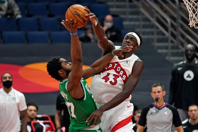 Toronto Raptors forward Pascal Siakam (43) blocks a shot by Boston Celtics forward Semi Ojeleye (37) on Monday, Jan. 4, 2021, in Tampa, Fla.