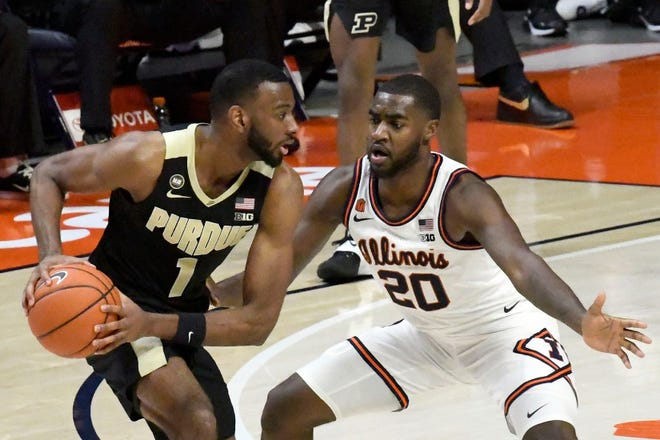 Purdue's forward Aaron Wheeler (1) is pressured by Illinois guard Da'Monte Williams (20) on Saturday, Jan. 2, 2021, in Champaign, Ill. Illinois is ranked No. 12 in the latest Associated Press poll.