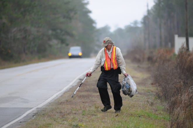 Cecil Ellis picking up litter along Gray Bridge Rd. in Shallotte in 2009.