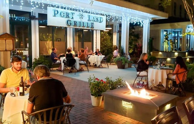 The patio at Port Land Grille in Lumina Commons near Wrightsville Beach, has added heaters and is partially covered for dining in less-than-perfect weather.
