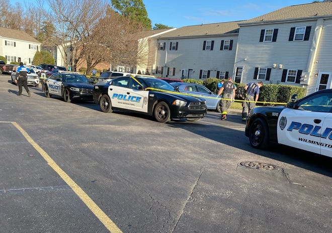 Police respond to a shooting at Cypress Grove Apartments on Jan. 4, 2021.