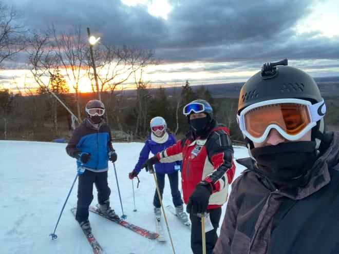 Rev. Doug Forbes and ski team members prepare to take a run at Blue Hills.