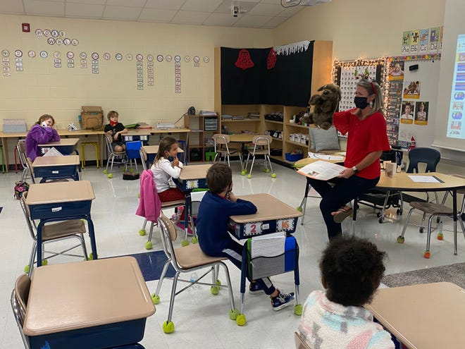 First-grade students in Mrs. Messer class at Creekside Elementary School participating in an interactive social-emotional learning activity. [CONTRIBUTED PHOTO]