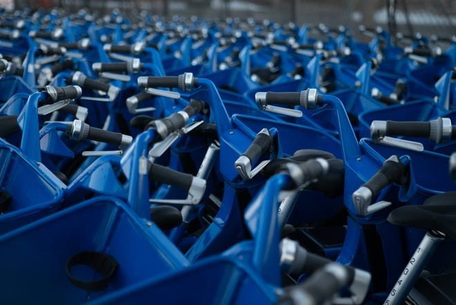 Hundreds of Metro Bikes remain lined up Monday afternoon outside the Topeka Metro facilities at 820 S.E. Quincy.