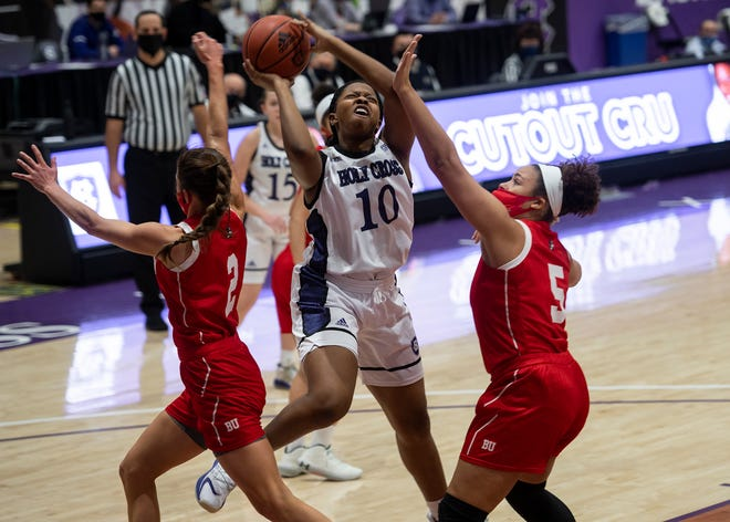 Holy Cross freshman Janelle Allen, shown here scoring earlier this season against Boston University, netted 12 points to share team-high honors with Kerry Flaherty in Saturday's loss at Lehigh.