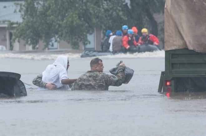 North Carolina Army National Guard members and local emergency services assist with evacuation efforts in Fayetteville, N.C., Oct., 2016. Heavy rains caused by Hurricane Matthew led to flooding as high as 5 feet in some areas.