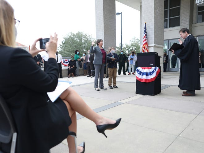 Alachua County Public Defender Stacy Scott takes the oath of office Tuesday after being re-elected to the position during a ceremony outside the Alachua County courthouse in Gainesville.