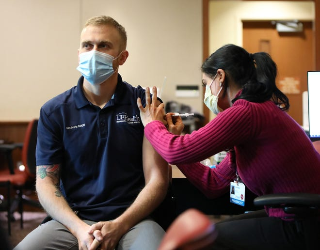 Sam Overly, a front line clinical leader in the ER at UF Health, gets the Pfizer-BioNTech COVID-19 vaccine at the UF Health Cancer Center on Jan. 4.