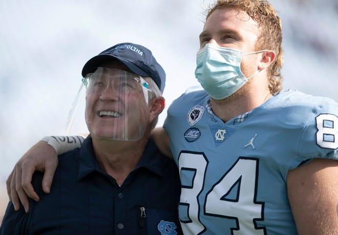 North Carolina tight end Garrett Walston, right, embraces coach Mack Brown last month during Senior Day ceremonies before the team's final home game of the season at Kenan Stadium.