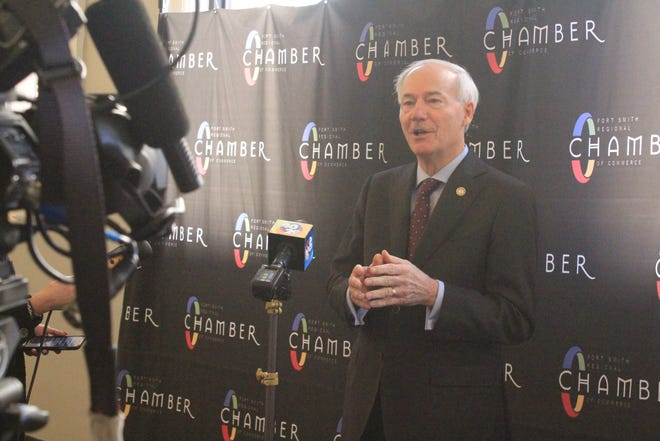 Arkansas Gov. Asa Hutchinson speaks to media following an economic development announcement on Monday, Jan. 4, 2021, at the Fort Smith Regional Chamber of Commerce.