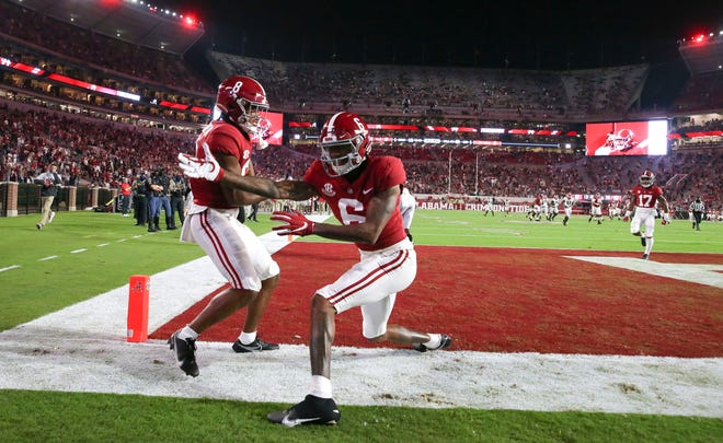 Alabama wide receivers John Metchie III, left, and DeVonta Smith celebrate Metchie's touchdown catch against Georgia in October.