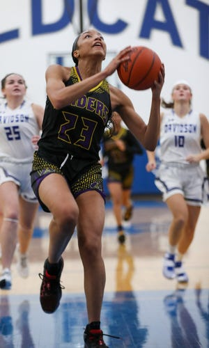 Reynoldsburg's Alexia Mobley drives in for a layup Dec. 29 against Hilliard Davidson. The junior guard, who played at Reynoldsburg as a freshman before transferring to Whitehall last season, is considering graduating early and beginning her career at Louisville next season.