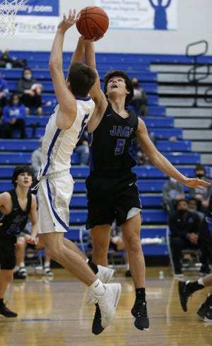 Cade Norris, one of two freshmen starting for Bradley, blocks a shot by Olentangy Liberty's Tylar Foster on Dec. 13. Through seven games, Norris was averaging 13.7 points, 3.1 assists and a team-high 8.0 rebounds.