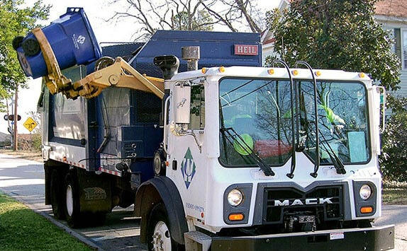 A Waste Connections truck makes its rounds picking up curbside trash. The Waxahachie City Council approved changes to the city's trash ordinance to go into effect April 1 that includes recycling pickup every other week, as well as a schedule for when polycarts may be placed for pickup.