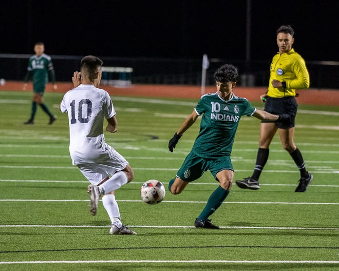 Waxahachie's Bryan Dominguez tees up a shot on goal during a home match against Life Oak Cliff last January. Dominguez is among the leading returnees for the Indians this winter.