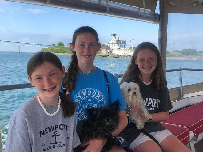 Three members of the Gibbons family participated in the essay competitions.  From left, with dogs Candy and Little Lady, is Tricia who won second place in the Patriots Pen competition, Erin who is the first place district winner in the Voices of Democracy competition, and Kerry who is the first place winner for the Patriots Pen competition.
