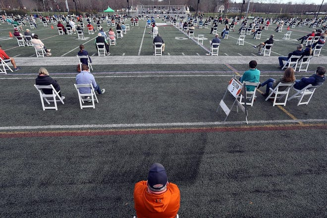 Hingham residents attend special town meeting at the turf field at Hingham High on Saturday, Nov. 21, 2020. This year's town meeting could include a citizen's petition for a zoning bylaw change.