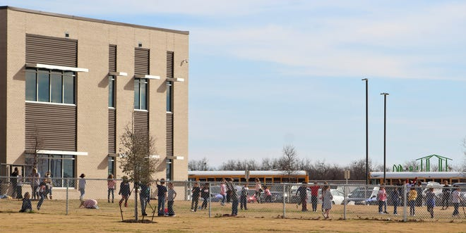 Taylor Elementary School students play outside on a sunny afternoon with the temperature in the mid-60s in Abilene. Tuesday was the first day of classes at the school, relocated from its former longtime site south of the Abilene Christian University campus.
