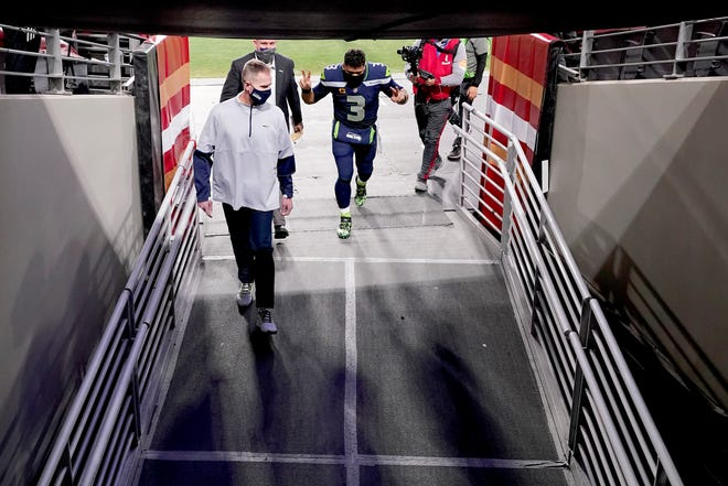 Seattle Seahawks quarterback Russell Wilson (3) leaves the field after an NFL football game against the San Francisco 49ers, Sunday, Jan. 3, 2021, in Glendale, Ariz. The Seahawks won 26-23. (AP Photo/Ross D. Franklin)