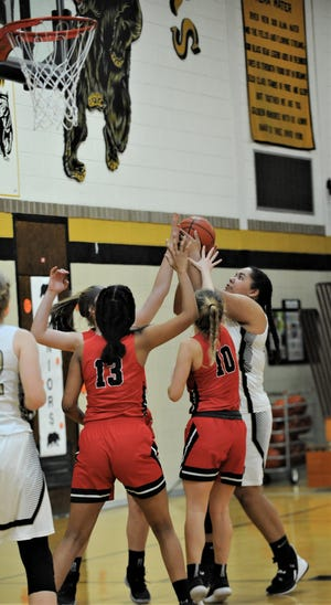 River View's Aaliyah Better goes up for a shot over several Coshocton defenders in Monday's game. The Lady Bears won 48-30.
