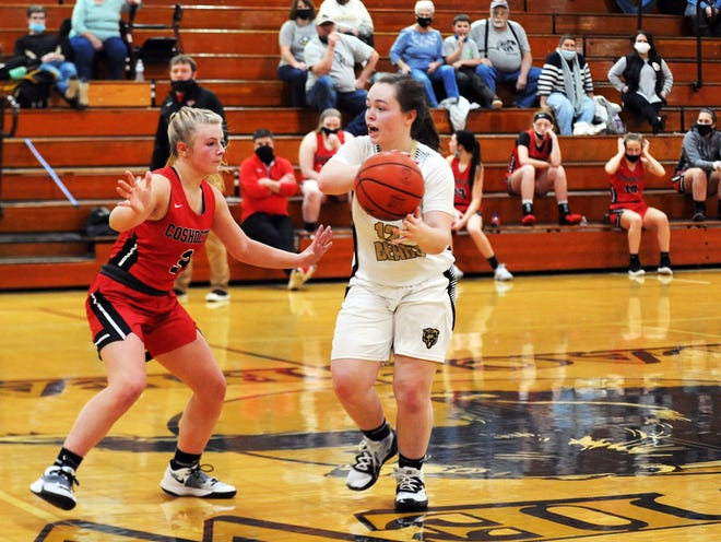 River View's Prestyn Patterson looks for an open teammate while being guarded by Coshocton's Keeley Murray during the Lady Bears' 48-30 win on Monday night at Luther Stover Gymnasium. Patterson scored a game-high 22 points.