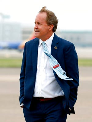 In this June 28, 2020 file photo, Texas' Attorney General Ken Paxton waits on the flight line for the arrival of Vice President Mike Pence at Love Field in Dallas.