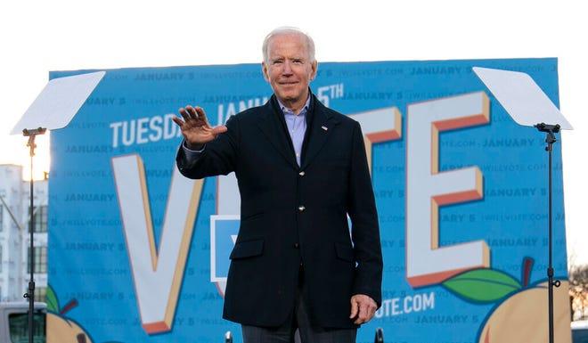 Presiden terpilih Joe Biden di Atlanta pada hari Senin, 4 Januari 2021, berkampanye untuk kandidat Senat Georgia AS Rev. Raphael Warnock dan Jon Ossoff.