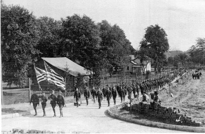 World War I soldiers march on Memorial Day in 1919.