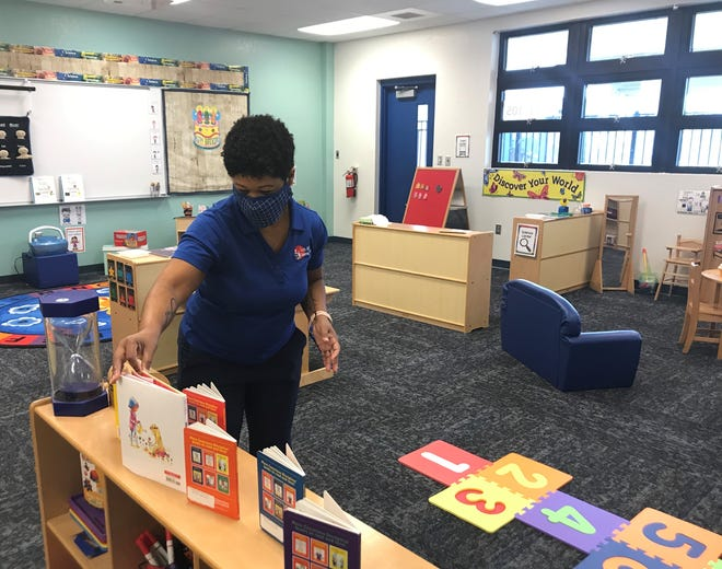 Tiffany Franklin, a coordinator for the department of teaching and learning, lines up books in a preschool classroom at James Stephens Pre-K Center in Fort Myers.