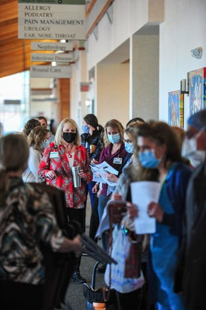 City-County Health Officer Trisha Gardner said the mask mandate will continue in Cascade County during a Board of Health meeting Wednesday morning.  The above photo is of Great Falls Clinic employees and providers waiting in line to receive the first batch of Covid-19 vaccinations.