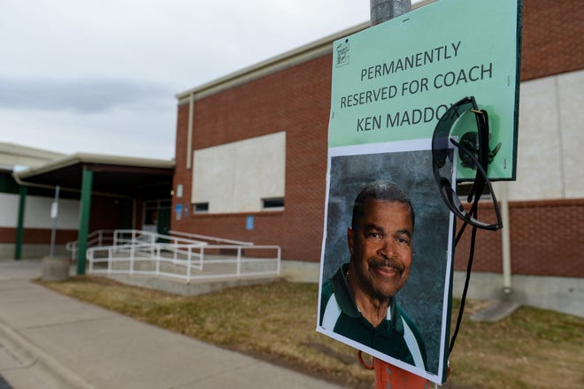 A basketball hoop has been erected over the cordoned parking space at East Middle School that has been permanently reserved as a memorial to Ken Maddox, a longtime teacher and coach in Great Falls, who passed away from Covid-19 complications in November 2020.