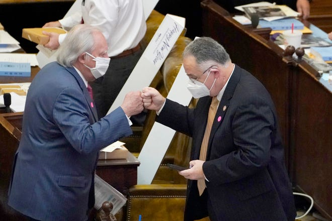 A sign of the pandemic fueled time is the new norm of greetings by fist bumping instead of shaking hands as seen by Republican Reps. John O. Read of Gautier and Gene Newman of Pearl during the first day of the 2021 Mississippi Legislature at the Capitol, Tuesday, Jan. 5, 2021, in Jackson, Miss.