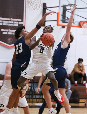 DeSales' Devin Perry (2) tried to split the Elizabethtown defense during their game at DeSales High School in Louisville, Ky. on Jan. 4, 2021.