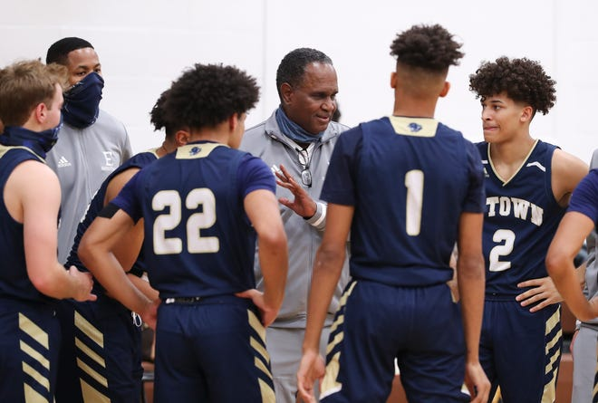 Elizabethtown head coach James E. Haire instructs his team against DeSales during their game at DeSales High School in Louisville, Ky. on Jan. 4, 2021.