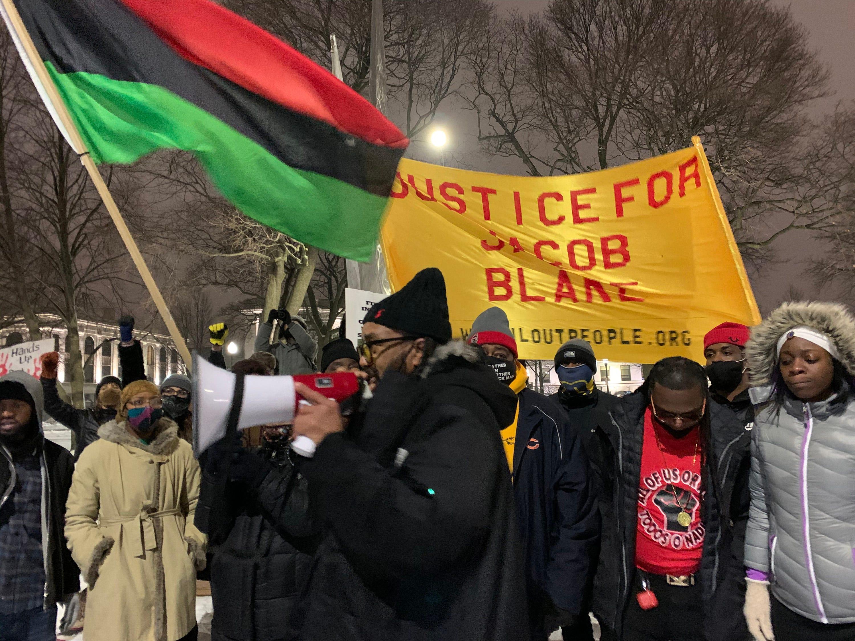 Justin Blake, Jacob Blake's uncle,  speaks during a rally at Civic Park in Kenosha on Monday, Jan. 4, 2021.