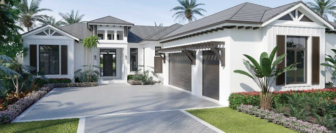 Imperial Homes' Burano model in Peninsula at Treviso Bay overlooks a lake and the 8th fairway of the community's TPC golf course.
