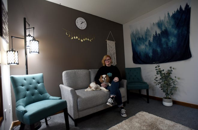 "Stacey Antle, co-owner of Hygge Behavioral Health & Wellness, along with dog, Opie, wants patients to feel ""cozy or comfortable"" in the Granville mental health practice. Hygge is a quality of coziness that makes a person feel content and comfortable."