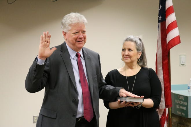 Gary Risley takes the oath of office, Monday, Jan. 4, 2021, in the San Juan County Commission chambers in Aztec.