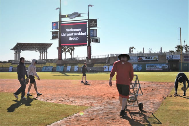 Former coaches and players from an Illinois youth travel ball team from the Chicago area work out during their Pensacola trip to experience the Blue Wahoos Airbnb.