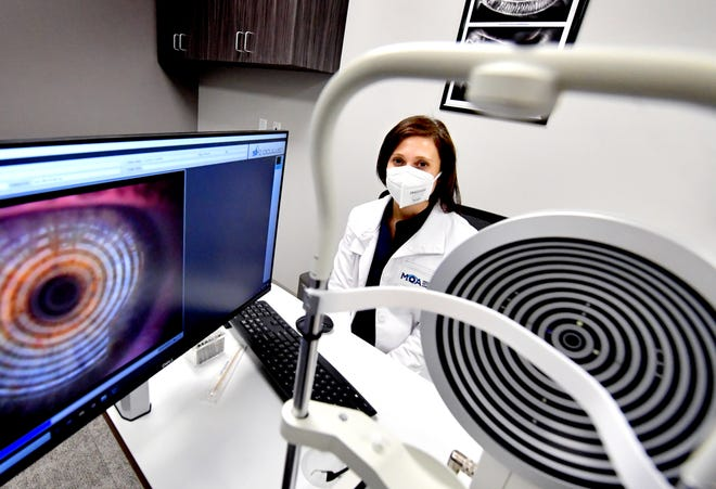 Dr. Leslie O'Dell, clinical director of Medical Optometry America, poses with an Oculus Keratograph at the recently-opened Shrewsbury office Tuesday, Jan. 5, 2021. The device performs corneal topography and dry eye analysis. Bill Kalina photo